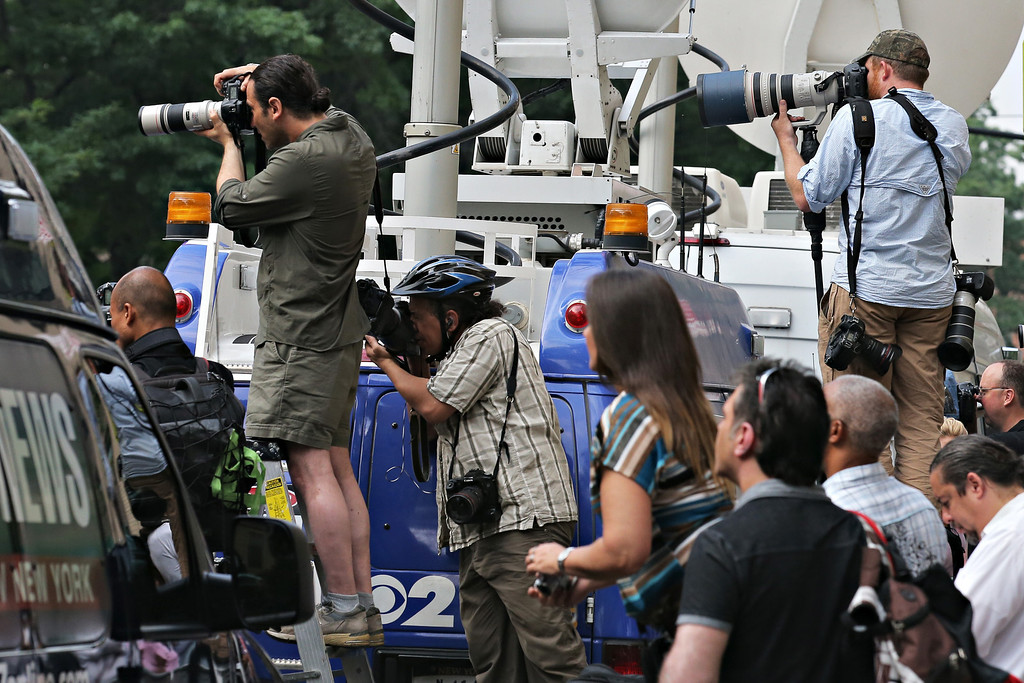 . Members of the media photograph attendees arriving at actor James Gandolfini\'s funeral at The Cathedral Church of St. John the Divine on June 27, 2013 in New York City.  (Photo by Andrew Burton/Getty Images)