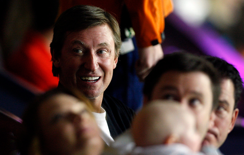 . Hall of Famer Wayne Gretzky attends an NHL hockey game between the Calgary Flames and Colorado Avalanche in Calgary, Alberta, Wednesday, March 27, 2013. (AP Photo/The Canadian Press, Jeff McIntosh)