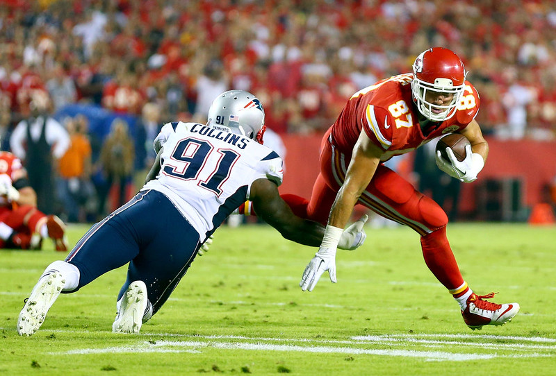 . Travis Kelce #87 of the Kansas City Chiefs runs the ball against  Jamie Collins #91 of the New England Patriots during the first half at Arrowhead Stadium on September 29, 2014 in Kansas City, Missouri.  (Photo by Dilip Vishwanat/Getty Images)