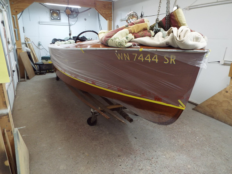 Starboard side masked for bottom paint and water line.