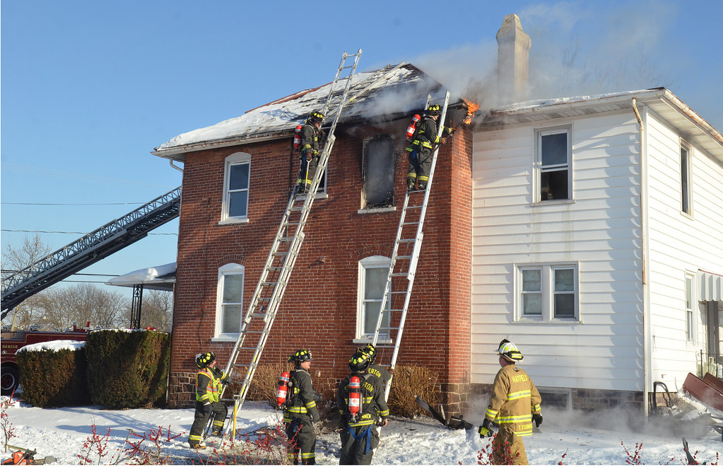 . Firefighters at scene of house fire on Forty Foot Road in Hatfield Township.   Thursday, Janury 23, 2014.  Photo by Geoff Patton