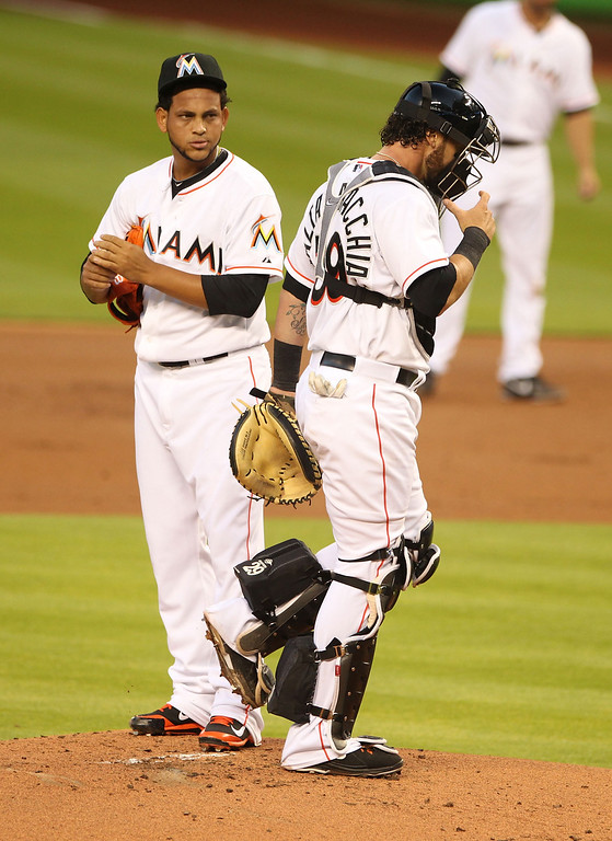 . Pitcher Henderson Alvarez #37 of the Miami Marlins chats with Catcher Jarrod Saltalamacchia #39 against the Colorado rockies during the first inning at Marlins Park on April 2, 2014 in Miami, Florida.  (Photo by Marc Serota/Getty Images)