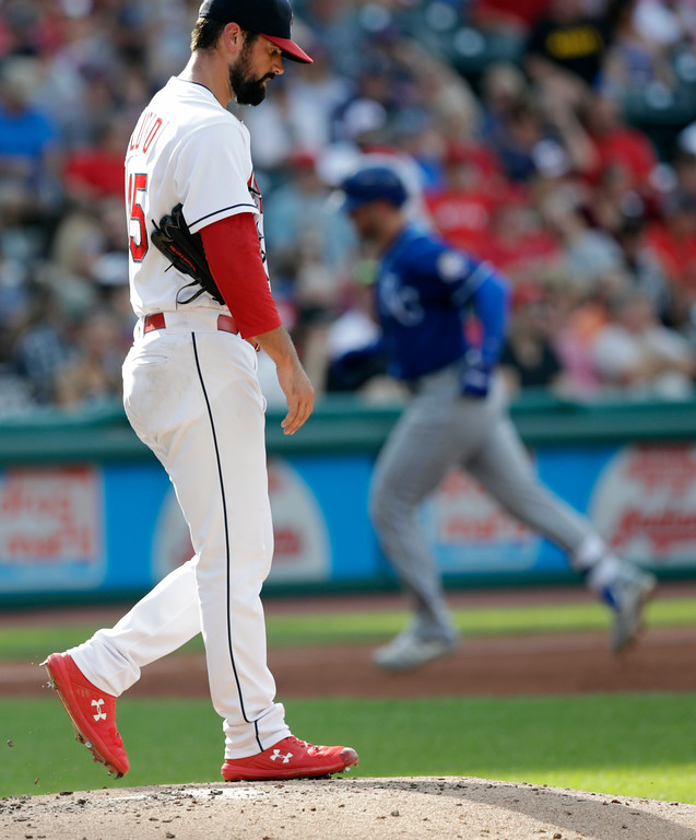 . Cleveland Indians starting pitcher Adam Plutko, left, waits for Kansas City Royals\' Ryan O\'Hearn to run the bases after O\'Hearn hit a solo home run in the fourth inning of a baseball game, Monday, Sept. 3, 2018, in Cleveland. (AP Photo/Tony Dejak)