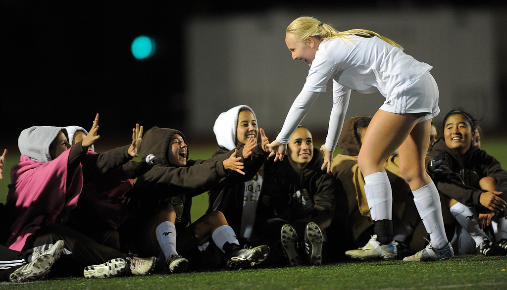 . TORRANCE - 02/12/2013 - (Staff Photo: Scott Varley/LANG) West High girls soccer beat Murrieta Valley on penalty kicks in their CIF Southern Section Division II wild-card matchup. After a 0-0 tie, West won 3-1 on PKs. West\'s Karlee Neer is congratulated by teammates after scoring on a penalty kick.