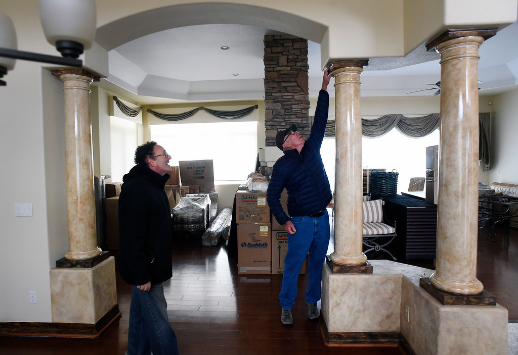 . Homeowners Jim Millman, left, and his neighbor Denny Cripps, middle, check out the damage to Millman\'s home in the  Broadmoor Bluffs on April 11, 2016 in Colorado Springs, Colorado.  The two neighbors are among 200 homeowners who have applied for federal bailouts because their home is being eaten up by collapsing expansive soil that is part of an ancient and massive landslide area.  Millman\'s home was recently condemned after the moving earth finally broke the sewer and gas pipes in the house. His house has cracked walls, uneven floors and is literally sliding down the mountain.  It is a problem that city officials have known about since the mid-1990\'s when city planners approved developments on what geologists have called some of the most unstable geology on the front range.  (Photo by Helen H. Richardson/The Denver Post)