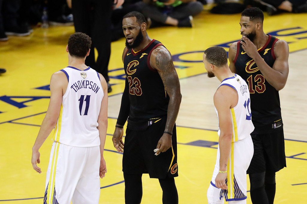 . Cleveland Cavaliers forward LeBron James (23) talks with Golden State Warriors guard Klay Thompson (11) during overtime of Game 1 of basketball\'s NBA Finals in Oakland, Calif., Thursday, May 31, 2018. The Warriors won 124-114. (AP Photo/Marcio Jose Sanchez)