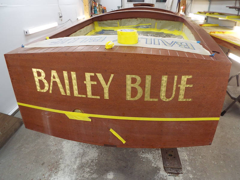 Gold leaf applied to the name. Ready for the out line.