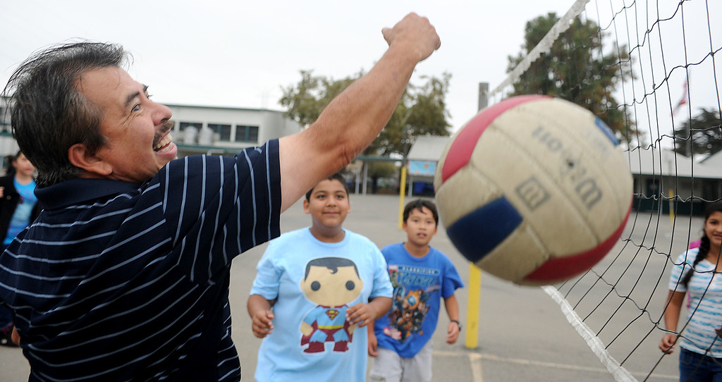 ". Parents played volleyball with their children during recess break at Elwin Elementary School in Baldwin Park, which  hosted, ""Bring Your Dad to School\"" Day Wednesday, October 2, 2013.(Walt Mancini/San Gabriel Valley Tribune)"