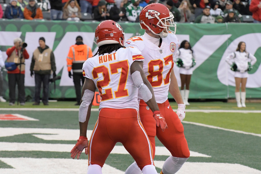 . Kansas City Chiefs\' Travis Kelce, right, celebrates his touchdown with Kareem Hunt (27) during the first half of an NFL football game against the New York Jets, Sunday, Dec. 3, 2017, in East Rutherford, N.J. (AP Photo/Bill Kostroun)