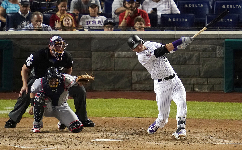. Colorado Rockies shortstop Trevor Story (27) hits a solo home run in the seventh inning during the 89th MLB baseball All-Star Game, Tuesday, July 17, 2018, at Nationals Park, in Washington. (AP Photo/Carolyn Kaster)