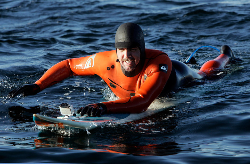 . Peter Mel paddles in after the final heat of the day on his way to winning the Mavericks Invitational surf contest Sunday, Jan. 20, 2013 at Princeton-by-the-Sea, Calif. (Karl Mondon/Staff)