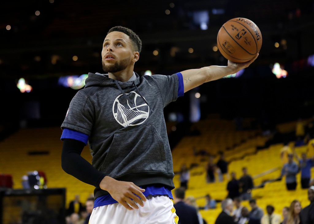 . Golden State Warriors\' Stephen Curry warms up before Game 1 of basketball\'s NBA Finals against the Cleveland Cavaliers Thursday, June 1, 2017, in Oakland, Calif. (AP Photo/Marcio Jose Sanchez)