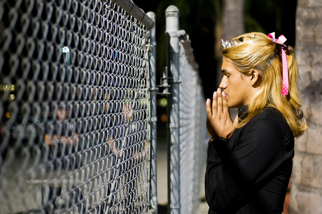 . Patrick Cordova, 16, a transgender senior, prays while he awaits for his dad to accompany him in the homecoming halftime at Citrus College Stadium in Glendora on Friday night, Sept. 27, 2013. (Photo by Watchara Phomicinda/ San Gabriel Valley Tribune)