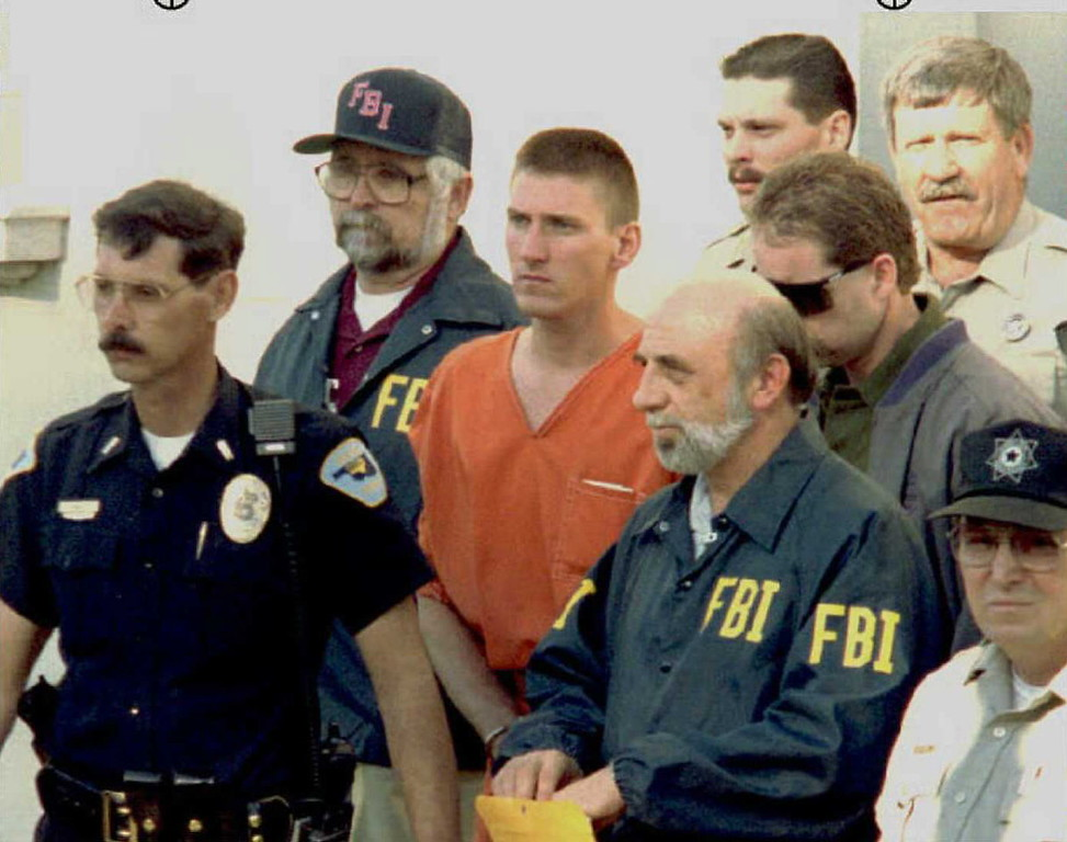 . Tim McVeigh, 27, (C), is led from the Noble County Courthouse by FBI agents 21 April 1995 after being charged in the bombing of the Alfred Murrah Federal Builing in Oklahoma City, OK.  (BOB DAEMMRICH/AFP/Getty Images)