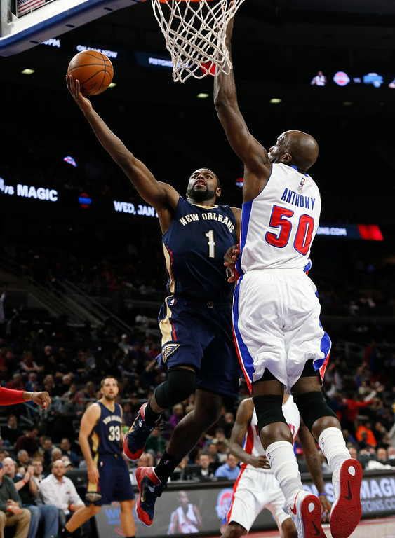 . New Orleans Pelicans guard Tyreke Evans (1) drives on Detroit Pistons center Joel Anthony (50) during the second half of an NBA basketball game in Auburn Hills, Mich., Wednesday, Jan. 14, 2015. (AP Photo/Paul Sancya)