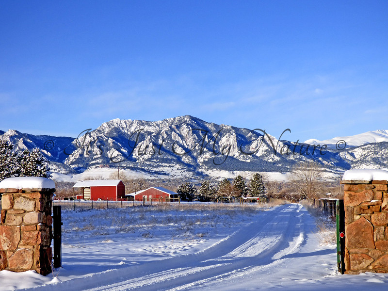 Snow-dusted Flatirons