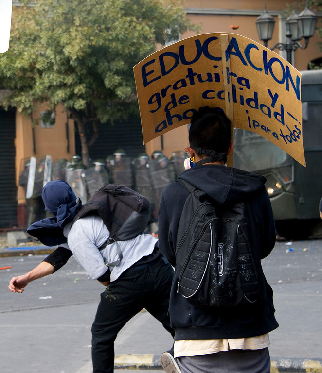 . Students clash with riot police during a protest to demand Chilean President Sebastian Pinera\'s government to improve the public education quality, in Santiago, on April 11,2013. MARTIN BERNETTI/AFP/Getty Images