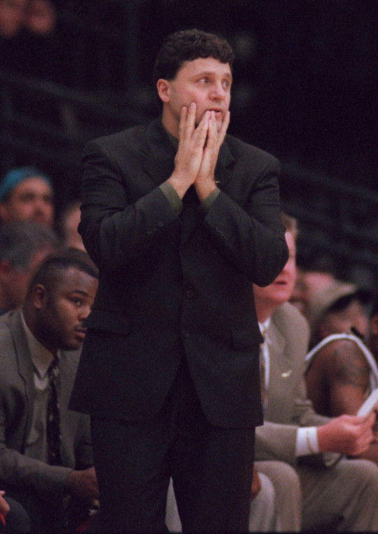 . Oakland University Coach Greg Kampe reacts to a play during the first half of his team\'s outing last night against Michigan State.
