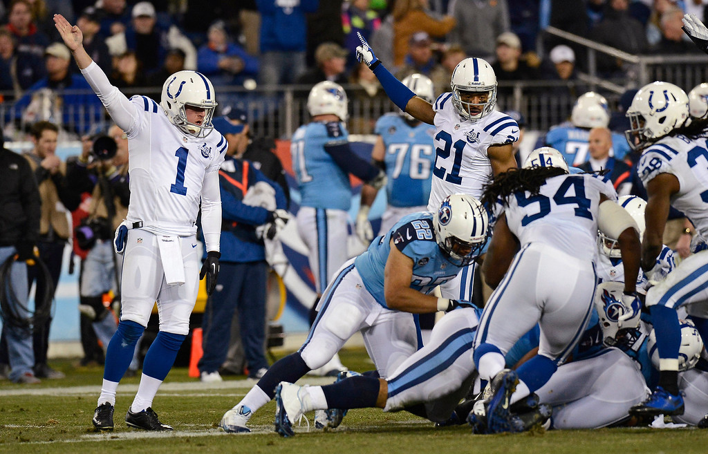 . Indianapolis Colts kicker Pat McAfee (1) and teammate Jalil Brown (21) signal that the Colts have recovered the ball after Tennessee Titans\' Devon Wylie fumbled a kickoff in the third quarter of an NFL football game Thursday, Nov. 14, 2013, in Nashville, Tenn. (AP Photo/Mark Zaleski)