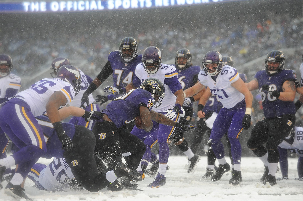 . Running back Bernard Pierce #30 of the Baltimore Ravens runs the ball against the Minnesota Vikings at M&T Bank Stadium on December 8, 2013 in Baltimore, Maryland. (Photo by Larry French/Getty Images)