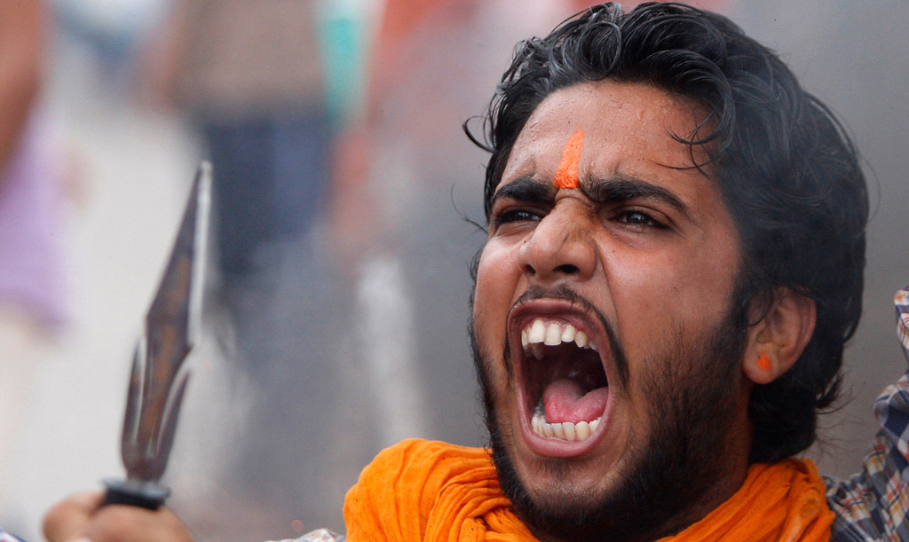 . A Hindu protestor shouts slogans against the state government after rival communities clashed in Kishtwar, in Jammu, India, Saturday, Aug. 10,2013. Indian forces fired warning shots Saturday to enforce a curfew and to push angry people back into their homes in Kishtwar, in the Indian portion of Kashmir where clashes between Muslims and Hindus during Eid celebrations killed at least two people and injured another 24.(AP Photo/Channi Anand)
