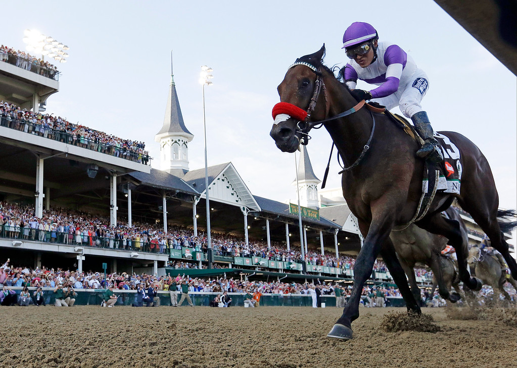 . Mario Guitierrez rides Nyquist to victory during the 142nd running of the Kentucky Derby horse race at Churchill Downs Saturday, May 7, 2016, in Louisville, Ky. (AP Photo/David J. Phillip)