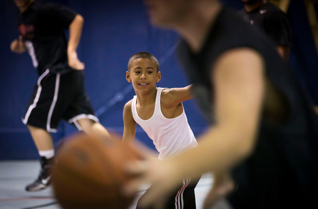 . Downey Christian high school varsity basketball player 11-year-old Julian Newman participates in Friday evening pickup basketball games at Downey Christian School in Orlando, Florida February 22, 2013. At 4 feet 5 inches tall, starting point guard Julian Newman stands waist high next to other players on his Florida high school basketball team. But his talent towers over the competition. At only 11, Newman leads the state of Florida in assists per game this season and ranks fifth nationally, according to Maxpreps.com, which maintains statistics on high school sports.  REUTERS/Scott Audette