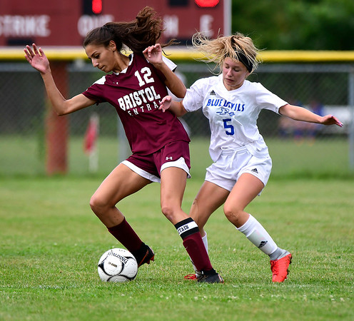 9/7/2018 Mike Orazzi | Staff Bristol Central's Adalia Malick (12) and Plainville's Skyler Ibitz (5) during Friday's soccer at BC.