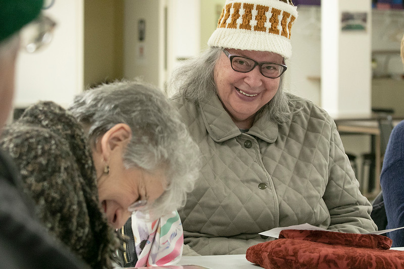The Leominster Senior Center holds a writing class every Friday afternoon from 1 p.m. to 3 p.m. run by Jane Lonnqvist of Fitchburg.  Linda Carroll, in hat, of Fitchburg has a good laugh with her fellow writers during class on Friday, Dec. 27, 2019. SENTINEL & ENTERPRISE/JOHN LOVE