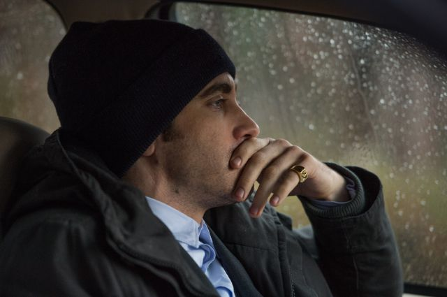 """. This image released by Warner Bros. Pictures shows Jake Gyllenhaal in a scene from \""""Prisoners.\"""" (AP Photo/Warner Bros. Pictures, Wilson Webb)"""