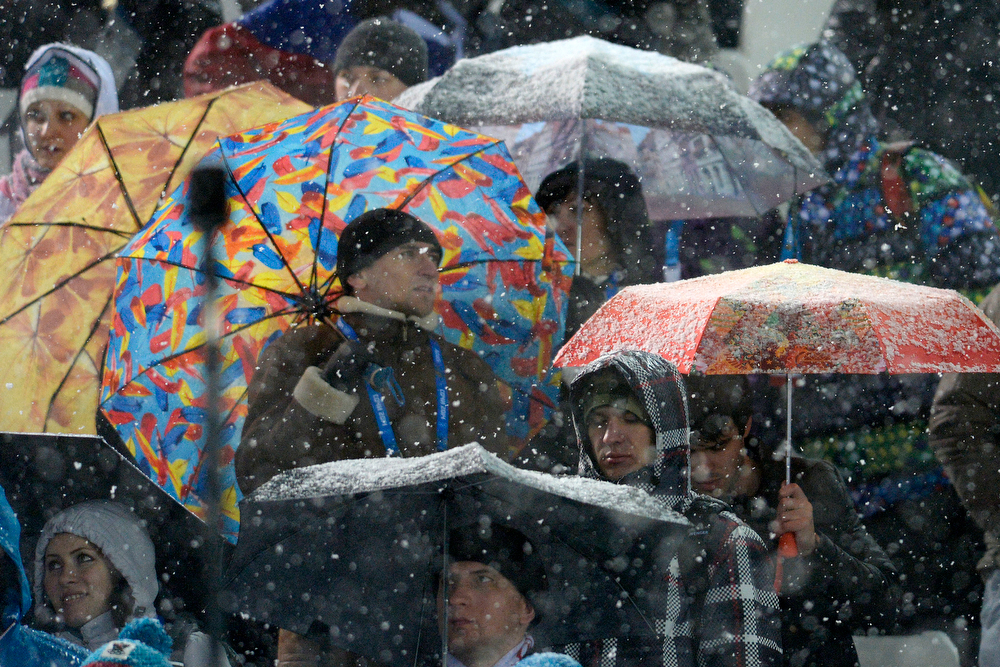 . Fans cover themselves with umbrellas as they watch the action during the men\'s ski halfpipe final. Sochi 2014 Winter Olympics on Tuesday, February 18, 2014. (Photo by AAron Ontiveroz/The Denver Post)