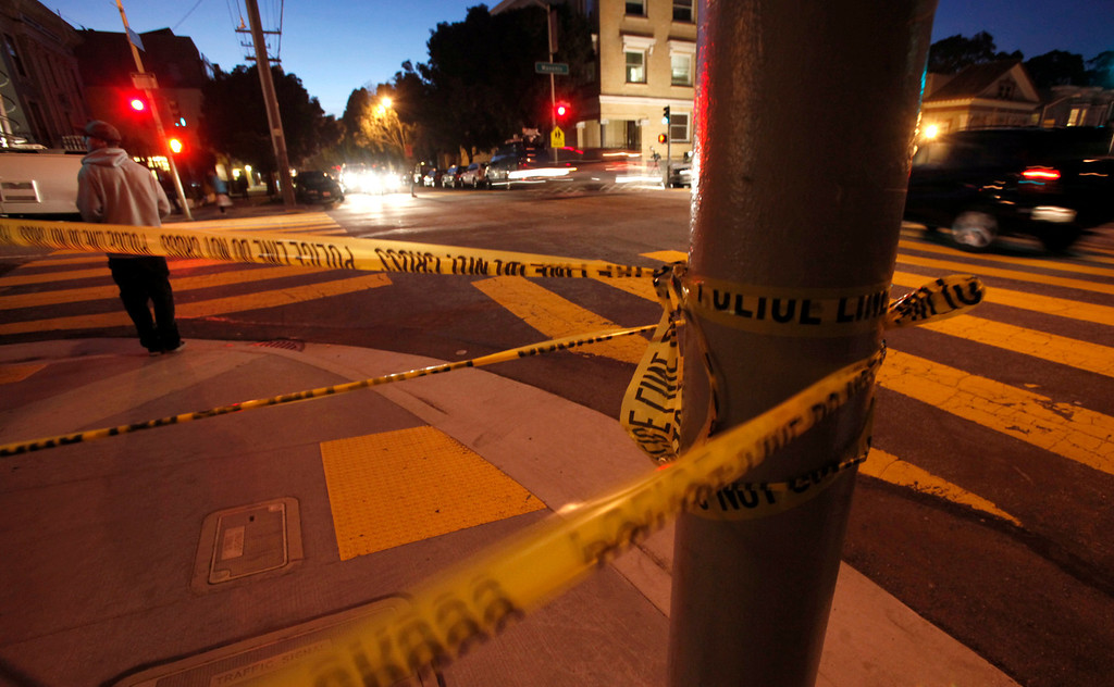 . Police tape is tied to a light post at Masonic Avenue and Page Street in San Francisco Tuesday Jan. 29, 2013, as police reportedly look for evidence in the disappearance of 10-year-old Kevin Collins on the same block 29 years ago.  (Karl Mondon/Staff)