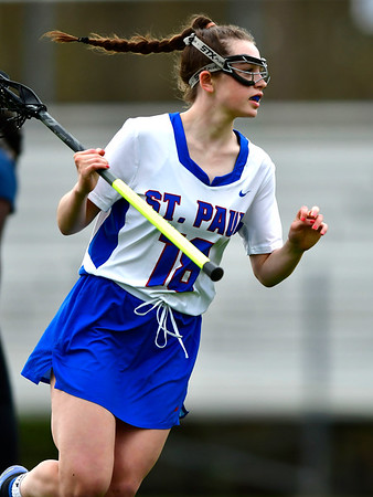 5/2/2019 Mike Orazzi | Staff St. Paul's Hannah Stanford (18) during Thursday's girls lacrosse with Amistad in Bristol.