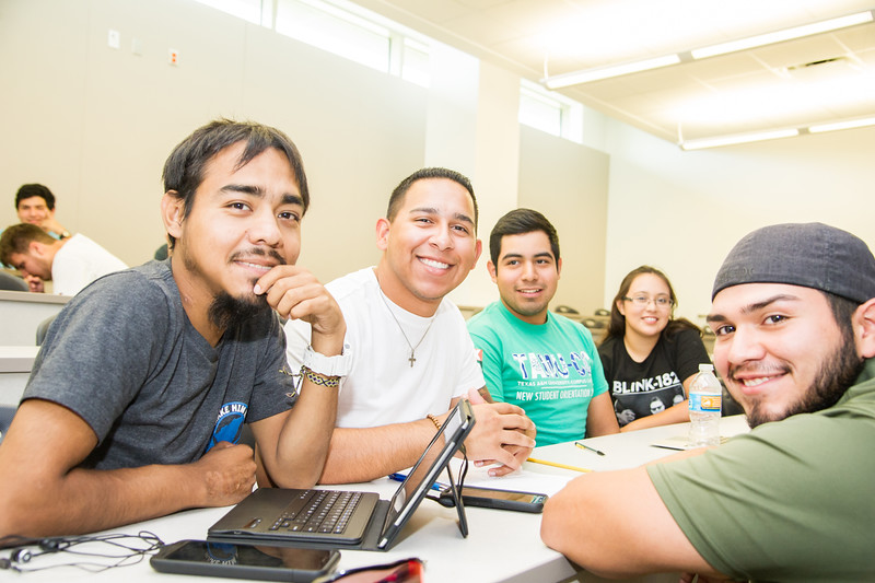 Students Jose Guerrro (Left), Jose Arrisula, Marco Graciani, Luis Gonzalez, and Luara Medina partner up to work on their public speaking project.
