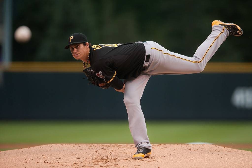 . Jeff Locke #49 of the Pittsburgh Pirates pitches against the Colorado Rockies in the first inning of a game at Coors Field on July 26, 2014 in Denver, Colorado. (Photo by Dustin Bradford/Getty Images)