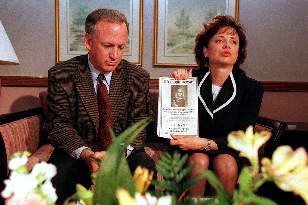 . Patsy Ramsey holds up a reward sign for any information  leading to the arrest of the murderer of daughter JonBenet Ramsey. The  couple met with a small selected group of the local Colorado  media after four months of silence. Their 6-year-old daughter was  murdered on Christmas night 1996. Photo by Helen H. Davis, The  Denver Post.
