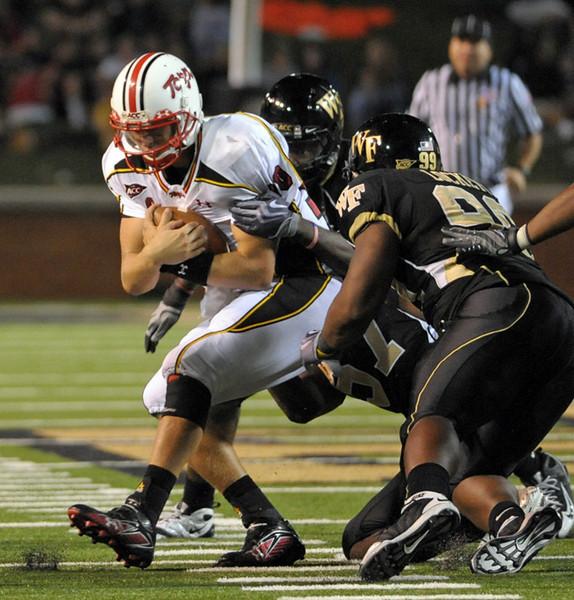 G Orange and M Lockett tackle C Turner.jpg
