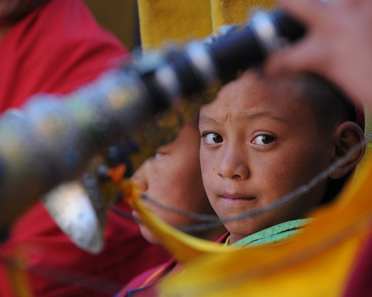 Young monk during a ceremony.