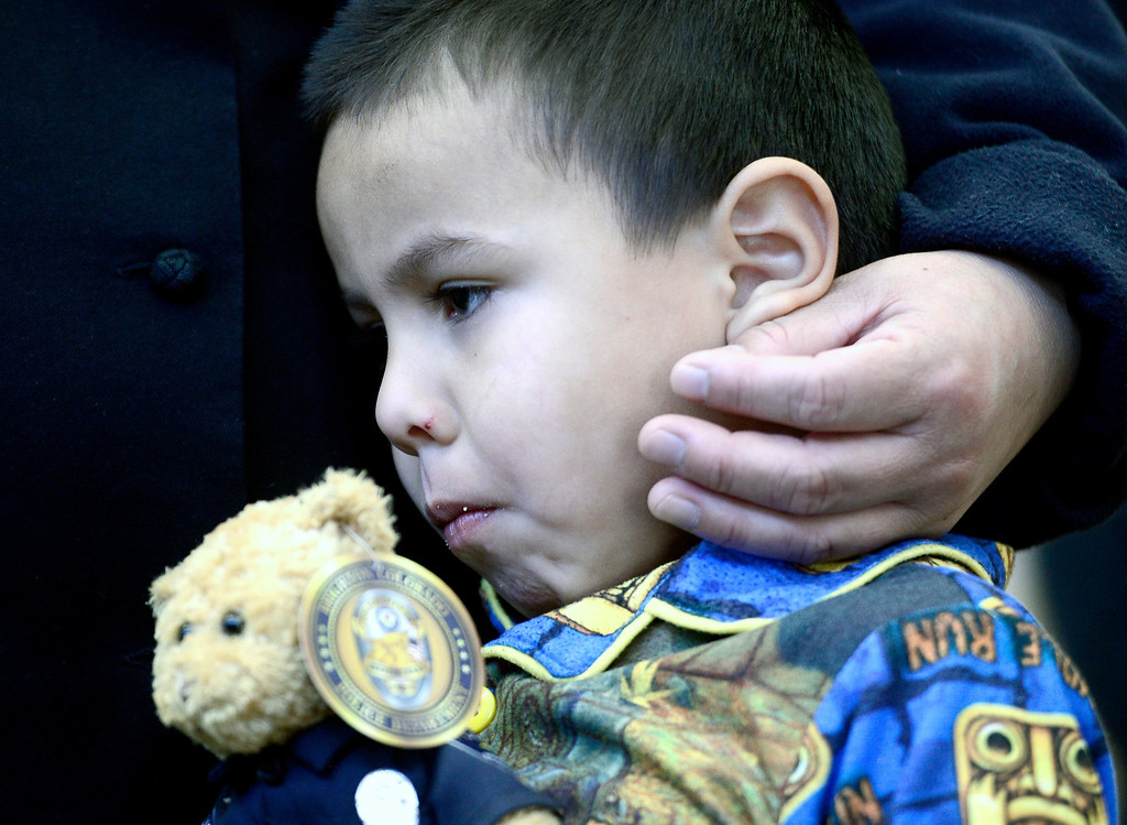 . Allen Rodriguez snuggles next to his mother, Marta Rodriguez at the police station in Brighton, Colorado March 12, 2014. The 4-year-old boy who was in the back of an SUV stolen from a Longmont gas station at 6:20 a.m. Wednesday. BOULDER DAILY CAMERA/ Mark Leffingwel