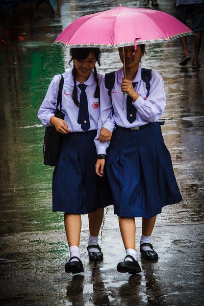 Lovely street life scene in the rain around the Oriental Pier.