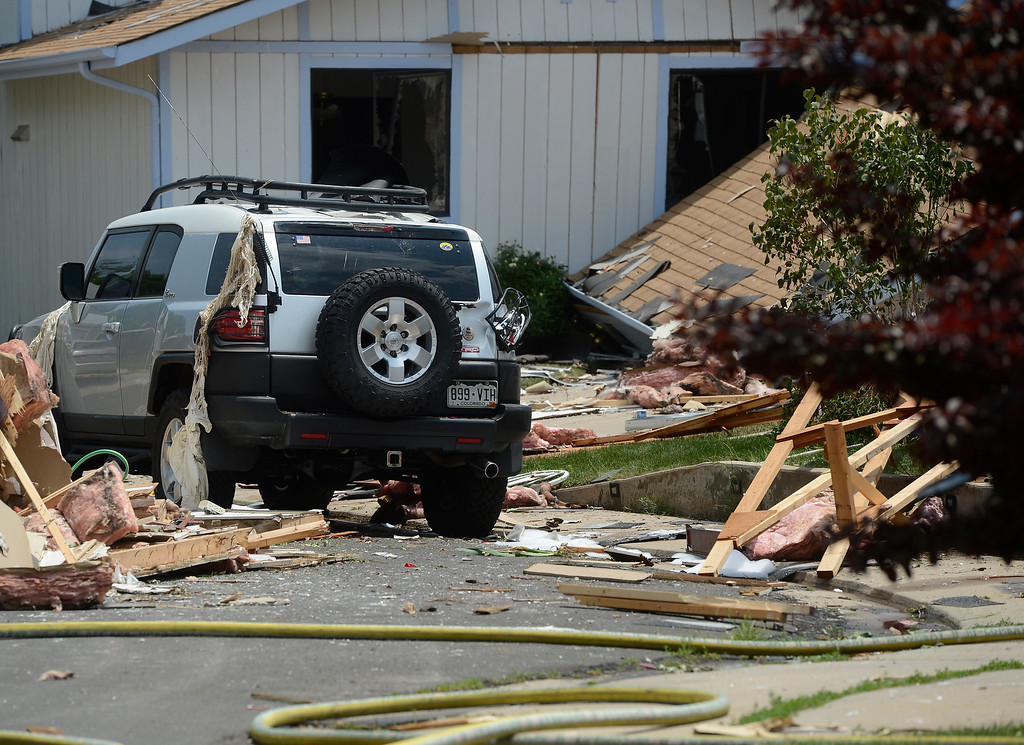 . Debris is scattered throughout the neighborhood after the house explosion on the 9300 block of Ingalls Street in Westminster, Colorado.  (Photo By Andy Cross/The Denver Post)