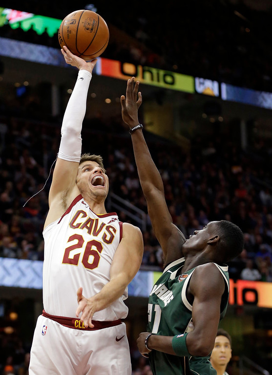 . Cleveland Cavaliers\' Kyle Korver (26) shoots over Milwaukee Bucks\' Tony Snell (21) in the first half of an NBA basketball game, Tuesday, Nov. 7, 2017, in Cleveland. (AP Photo/Tony Dejak)