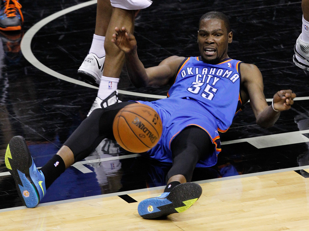 . Kevin Durant #35 of the Oklahoma City Thunder reacts in the first half while taking on the San Antonio Spurs in Game One of the Western Conference Finals during the 2014 NBA Playoffs at AT&T Center on May 19, 2014 in San Antonio, Texas.  (Photo by Chris Covatta/Getty Images)