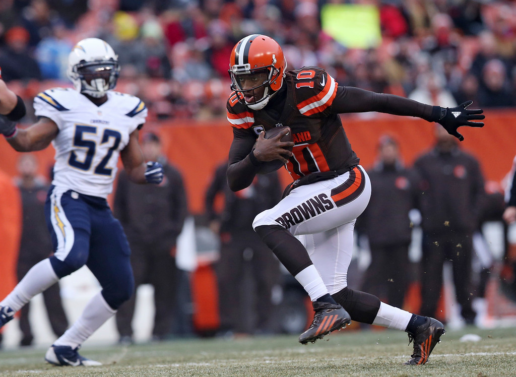 . Cleveland Browns quarterback Robert Griffin III (10) scrabbles against the San Diego Chargers in the first half of an NFL football game, Saturday, Dec. 24, 2016, in Cleveland. (AP Photo/Aaron Josefczyk)