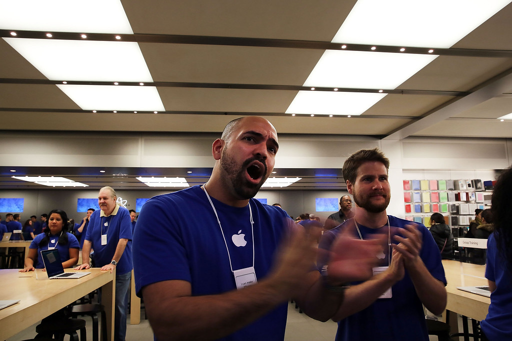 . Apple Store employees cheer as the first customers in line walk into the store to purchase the new iPad Air, the fifth generation of its tablet on November 1, 2013 in New York City. (Photo by Spencer Platt/Getty Images)