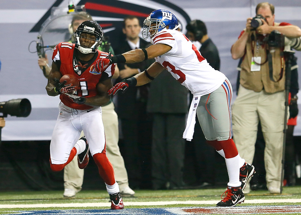 Description of . Julio Jones #11 of the Atlanta Falcons pulls in this touchdown reception against the Corey Webster #23 of the New York Giants at Georgia Dome on December 16, 2012 in Atlanta, Georgia.  (Photo by Kevin C. Cox/Getty Images)