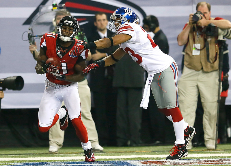 . Julio Jones #11 of the Atlanta Falcons pulls in this touchdown reception against the Corey Webster #23 of the New York Giants at Georgia Dome on December 16, 2012 in Atlanta, Georgia.  (Photo by Kevin C. Cox/Getty Images)