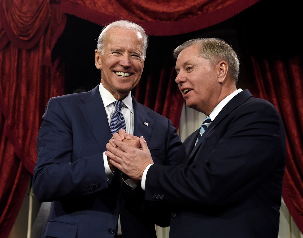. Vice President Joe Biden shares a laugh with Sen. Lindsey Graham, R-S.C. before Biden administered the Senate oath during a ceremonial re-enactment swearing-in ceremony, Tuesday, Jan. 6, 2015, in the Old Senate Chamber on Capitol Hill in Washington. (AP Photo/Susan Walsh)