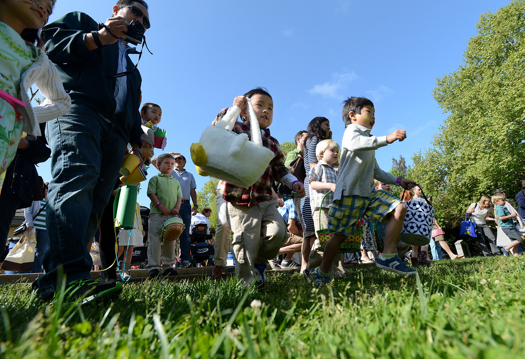 ". Children dash after Easter eggs during the Town of Danville\'s ""Eggstravaganza\"" held at the Danville Community Center in Danville, Calif., on Saturday, April 12, 2014. The event featured egg hunts for children of all ages as well as fun activities and snacks. (Dan Honda/Bay Area News Group)"