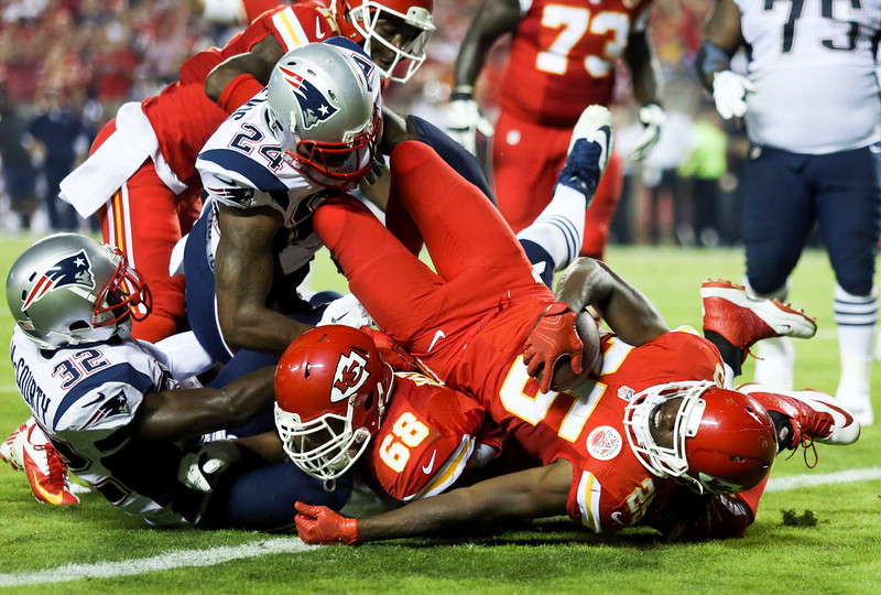 . Kansas City Chiefs running back Jamaal Charles, front right, falls into the end zone after catching a 5-yard pass for a touchdown during the second quarter of an NFL football game against the New England Patriots, Monday, Sept. 29, 2014, in Kansas City, Mo. (AP Photo/Ed Zurga)